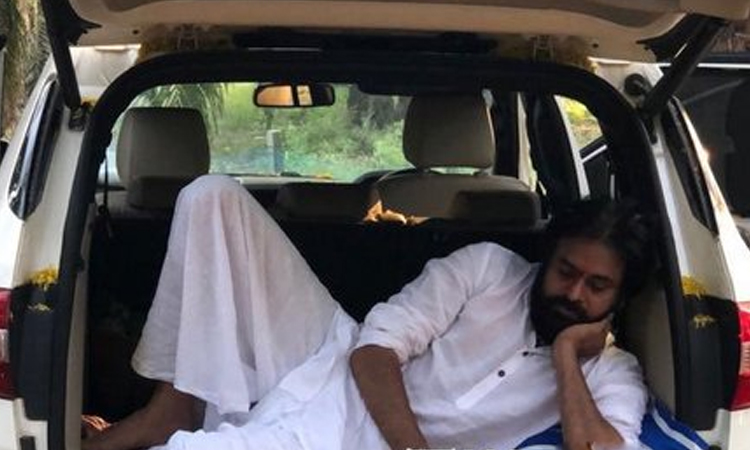 Janasena Chief Pawan Kalyan rests in his car during his campaign